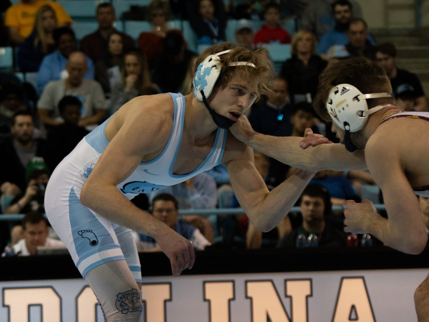 UNC redshirt sophomore Zach Sherman wrestles against his opponent in the match against Arizona State in the Carmichael Arena on Sunday, Feb. 23, 2020. Zach won this bout but UNC lost 9-22 overall.