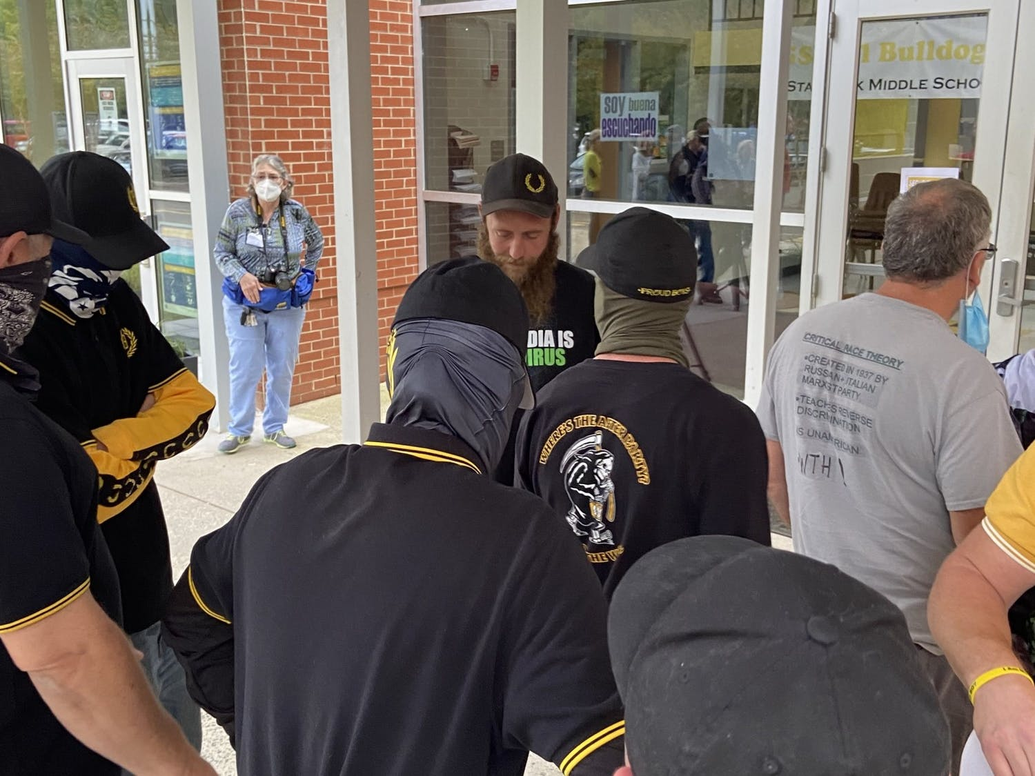 The Proud Boys stand outside of the Orange County Schools Board of Education meeting on Oct. 11. Photo courtesy of Allison Mahaley.