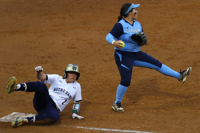 Berlynne Delamora attempts to throw out a base runner during Monday night's game against Notre Dame.