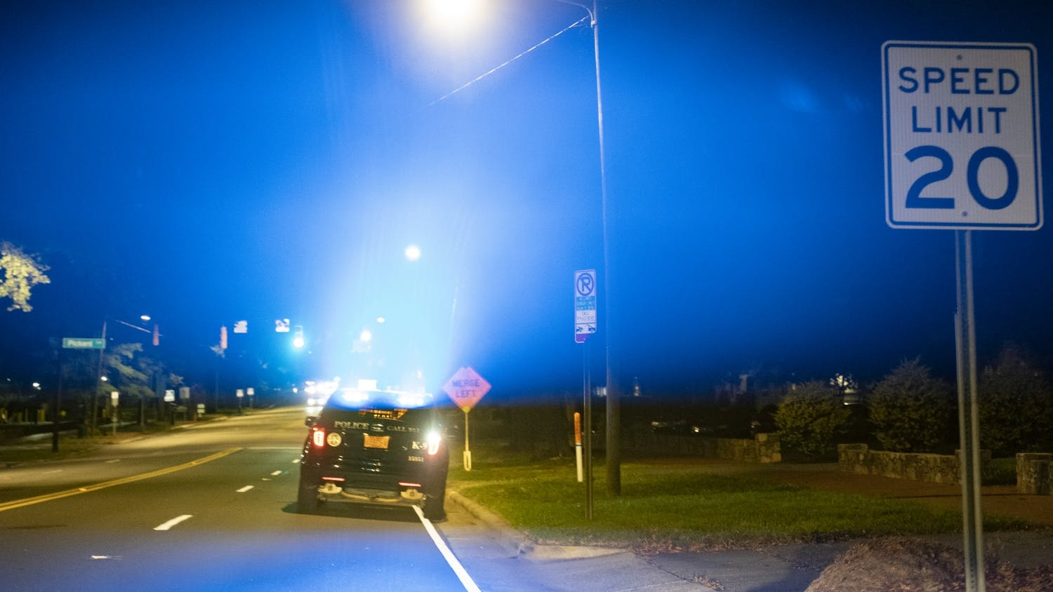 A police car parked on Franklin Street flashes its lights on Saturday, Aug. 29, 2020.