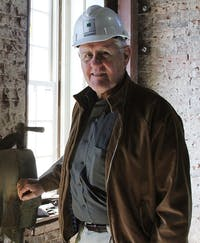 Grimsley Hobbs, Jr. of Hobbs Architecture stands proudly in the  Chatham County Courthouse that his company is currently rebuilding after it burned in a catastrophic fire in March 2010. The courthouse is expected to be finished in December.