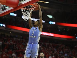 UNC guard Leaky Black (1) dunks during the game against NC State in PNC Arena Tuesday, Jan. 8, 2019. UNC defeated NC State 90-82.