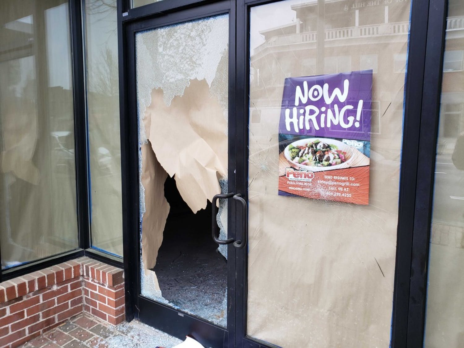 The storefronts of Sup Dogs and what was Tama Tea have been shattered. According to the Town, it seems no one entered the building, but instead through chairs to shatter the glass.