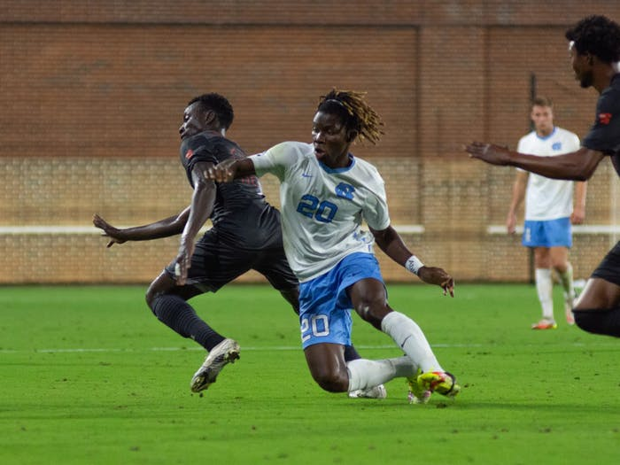 UNC sophomore forward Ernest Bawa (20) goes for the ball during the Sept. 14, 2021, men's soccer game against Campbell University. Carolina walked away with a home-field 1-0 win.