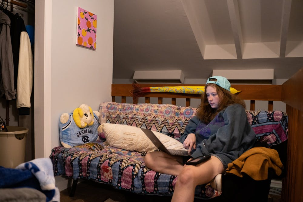 UNC sophomore Samantha Beecham attends an online class from her home in Chapel Hill on Wednesday, Aug. 19, 2020.