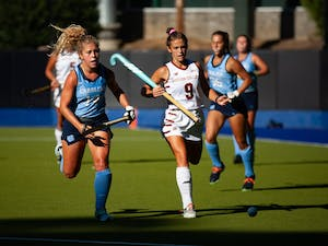 In the Sept. 24 field hockey match against Boston College, sophomore midfielder/fullback Katie Dixon (14) races for the ball against a Boston College defender. At half-time, UNC was winning 2-0.