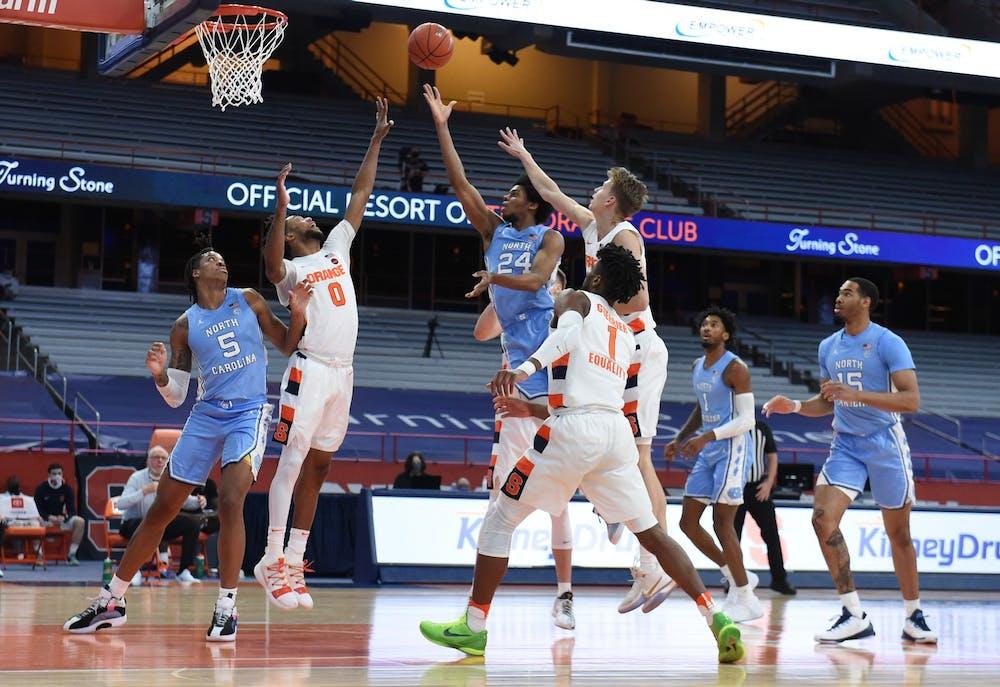 North Carolina Tar Heels guard Kerwin Walton (24) slices the lane  in a game between Syracuse and North Carolina  at the Carrier Dome in Syracuse N.Y. March 1, 2021. Photo courtesy of Dennis Nett/Syracuse Athletics.