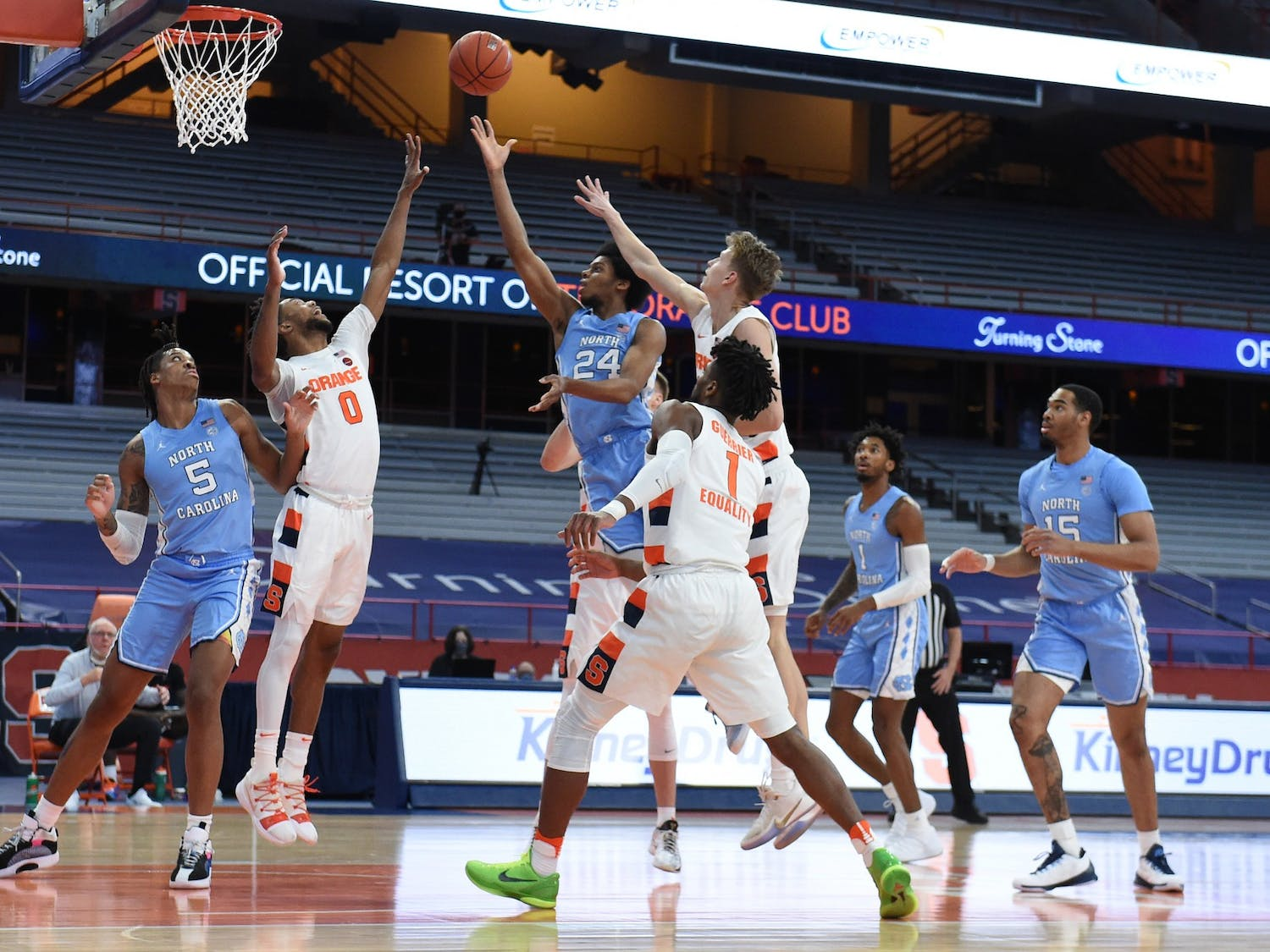 North Carolina Tar Heels guard Kerwin Walton (24) slices the lane  in a game between Syracuse and North Carolina  at the Carrier Dome in Syracuse N.Y. March 1, 2021. Photo courtesy of Dennis Nett/Syracuse Athletics.