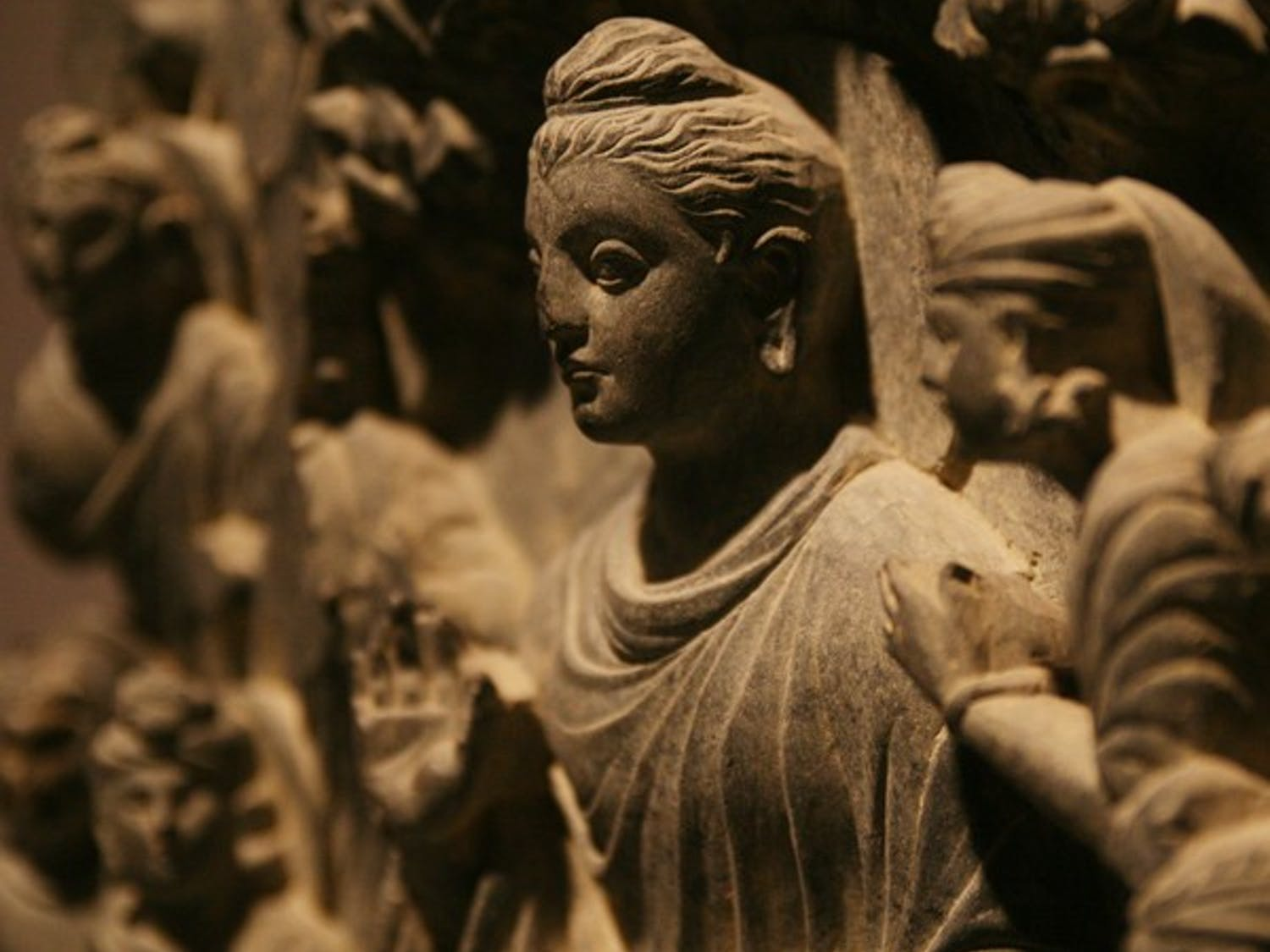 Many different media make up the exhibit, including this stone carving of Buddha.  DTH/Andrew Johnson