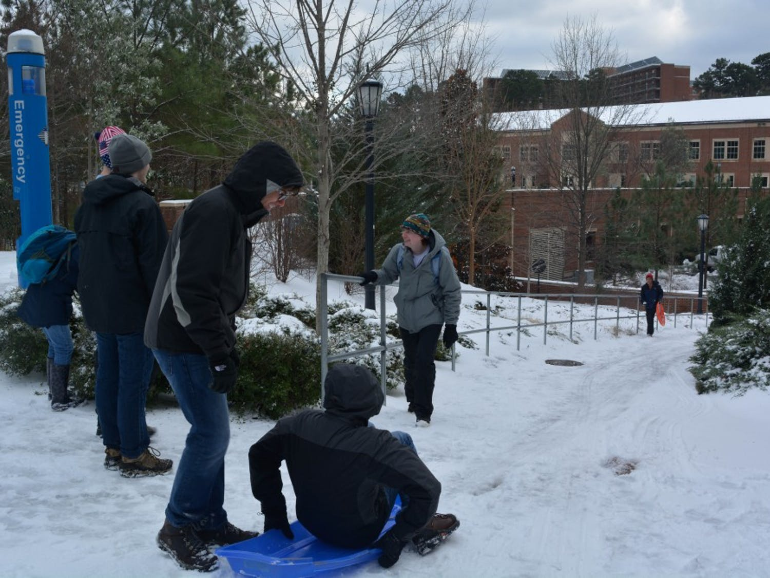 Students and community members sled on campus.