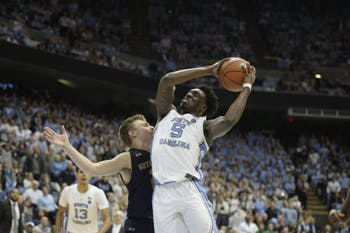 First-year forward Nassir Little (5) dunks against Notre Dame on Tuesday night. UNC won 75-69. Little had 11 points during his 18 minutes played.