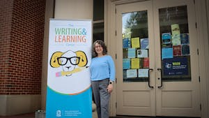 Kimberly Abels, the director of the Writing and Learning Center, poses outside of the Student and Academic Services Building on Tuesday, June 8.