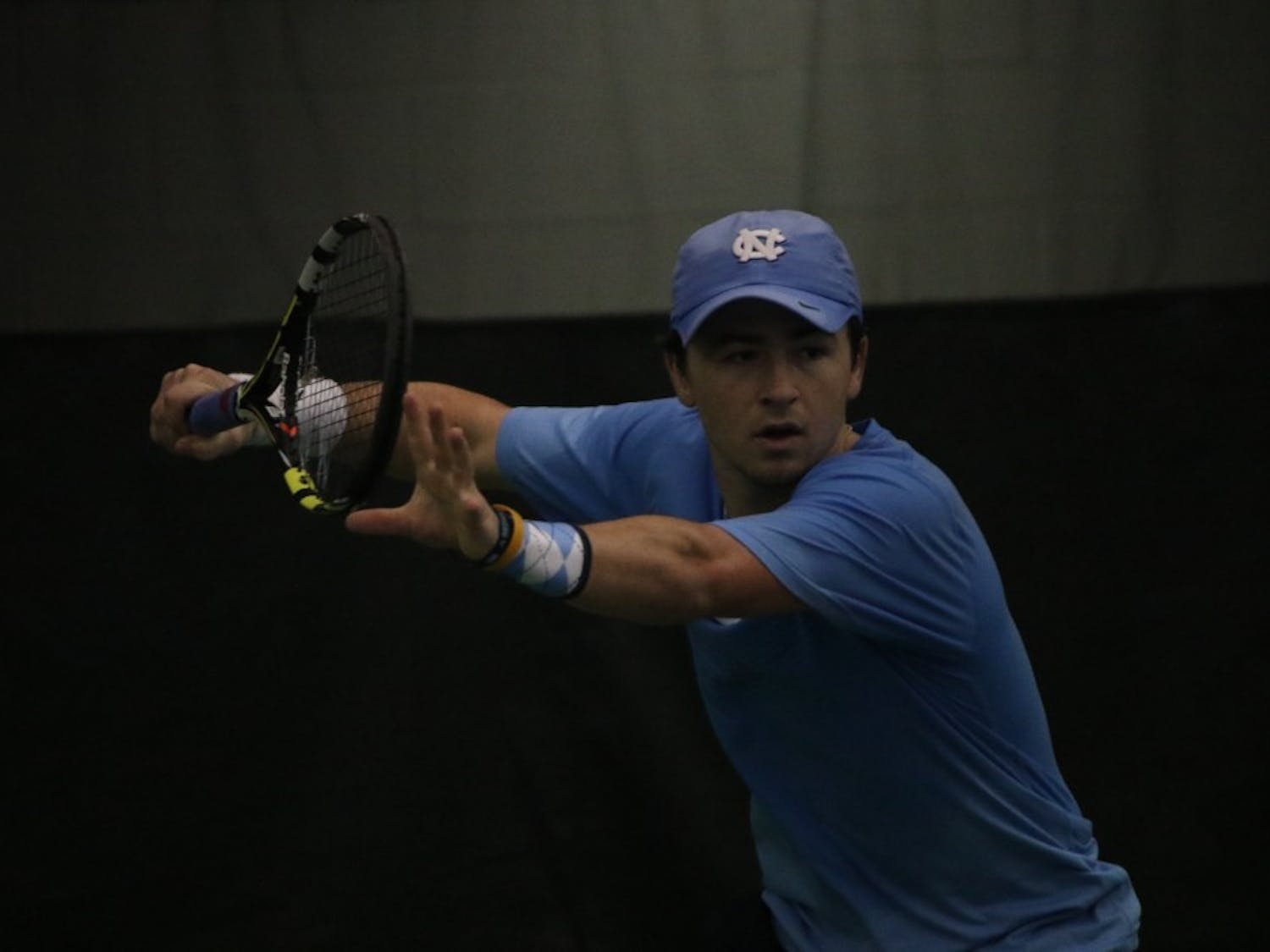 Junior Ronnie Schneider prepares to return a volley with a forehand hit in UNC men's tennis's route of Wofford on Sunday.