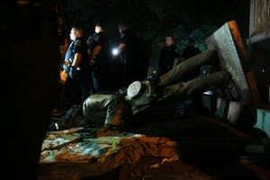 Police surround Silent Sam on Aug. 20 after the Confederate monument was pulled down by demonstrators.