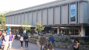 Students move between classes by the Robert B. House Undergraduate Library on Monday Oct. 22, 2018.