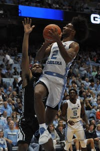 UNC first-year guard Coby White (2) takes a shot during exhibition game against Mount Olive on Friday Nov. 3.