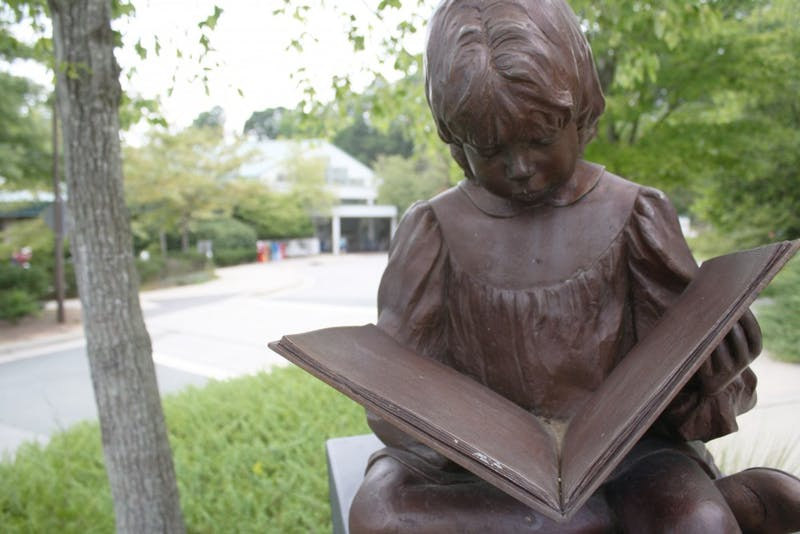 Once Upon a Time, sculpted by Betty Branch and commissioned by Roanoke City Library Foundation, outside the Chapel Hill Public Library.