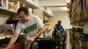 (From left) Warner Lamar and Samveg Desai are both students at UNC-Chapel Hill who volunteer at the Inter-Faith Food Pantry in Carrboro. The IFC pantry also provides families with basic hygiene needs such as soap, shampoo, and toothpaste. These items are not often given out or even offered in other food pantries but IFC has thought beyond food and offered those in need with everyday essentials that everyone should have access to. Shot on Tuesday, Oct. 2, 2018.