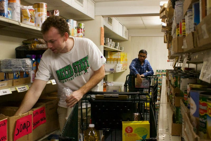 Warner Lamar (left) and Samveg Desai (right) are both students at UNC-Chapel Hill who volunteer at the Inter-Faith Food Pantry in Carrboro. The IFC pantry also provides families with basic hygiene needs such as soap, shampoo, and toothpaste. These items are not often given out or even offered in other food pantries but IFC has thought beyond food and offered those in need with everyday essentials that everyone should have access to. Shot on Tuesday, Oct. 2, 2018.