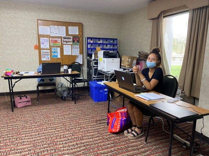 Ka'Tierra Truitt, organizer of the IFC housing project, smiles at her desk. Photo courtesy of Jennifer Gill.