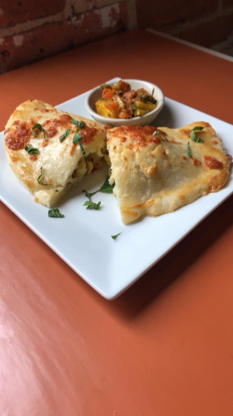 The newly opened Savor Eatery and Bakery serves empanadas with mango salsa. The bakery opened on Feb. 9, 2020. Photo courtesy of Stephanie Sherman.
