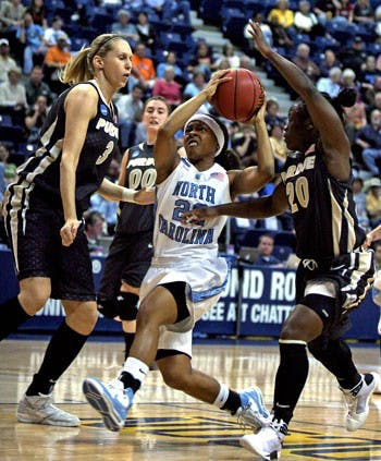 UNC's Cetera DeGraffenreid (22) drives into the lane against Perdue's Natasha Bogdanova (3) and FahKara Malone (20) during the first half of the Lady Tar Heels game against the Lady Boilermakers.The Boilermakers defeated the Tar Heels 85-70 on Monday to advance to the Women's NCAA Tournament Sweet 16.