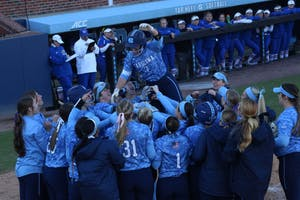 Senior Taylor Wike (7) is lifted up by her teammates after a home run against Kansas on March 3 in Anderson Stadium.