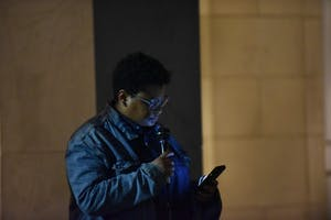 Maya Little reads her court statement across the street from where Silent Sam stood on Monday Oct. 15, after her court proceedings earlier in the day.