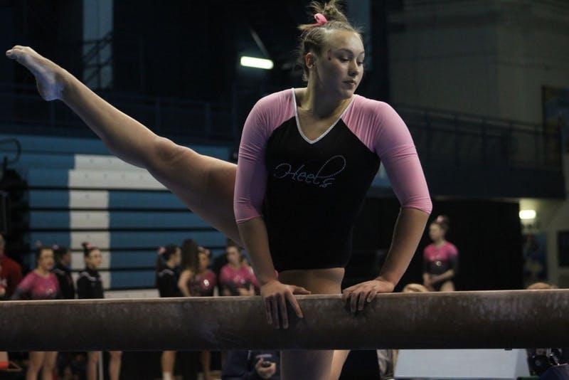 Senior Kaitlynn Hedelund competes against Brown during a North Carolina gymnastics meet on Feb. 19 in Carmichael Arena.