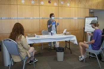 Nurse practitioner Jean McDonald administers COVID-19 saliva tests to students in the Student Union on Wednesday, Oct. 7, 2020.
