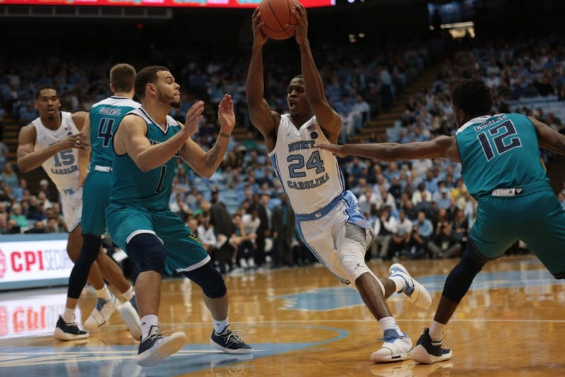 Senior guard Kenny Williams (24) rushes to the basket past UNCW in Smith Center on Wednesday, Dec. 5, 2018. UNC won 97-69.