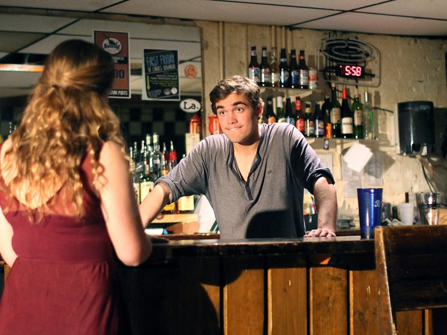 Camille Oswald (left) plays W and Sam Fletcher (right) plays John in Lab! Theatre's production of Cock.