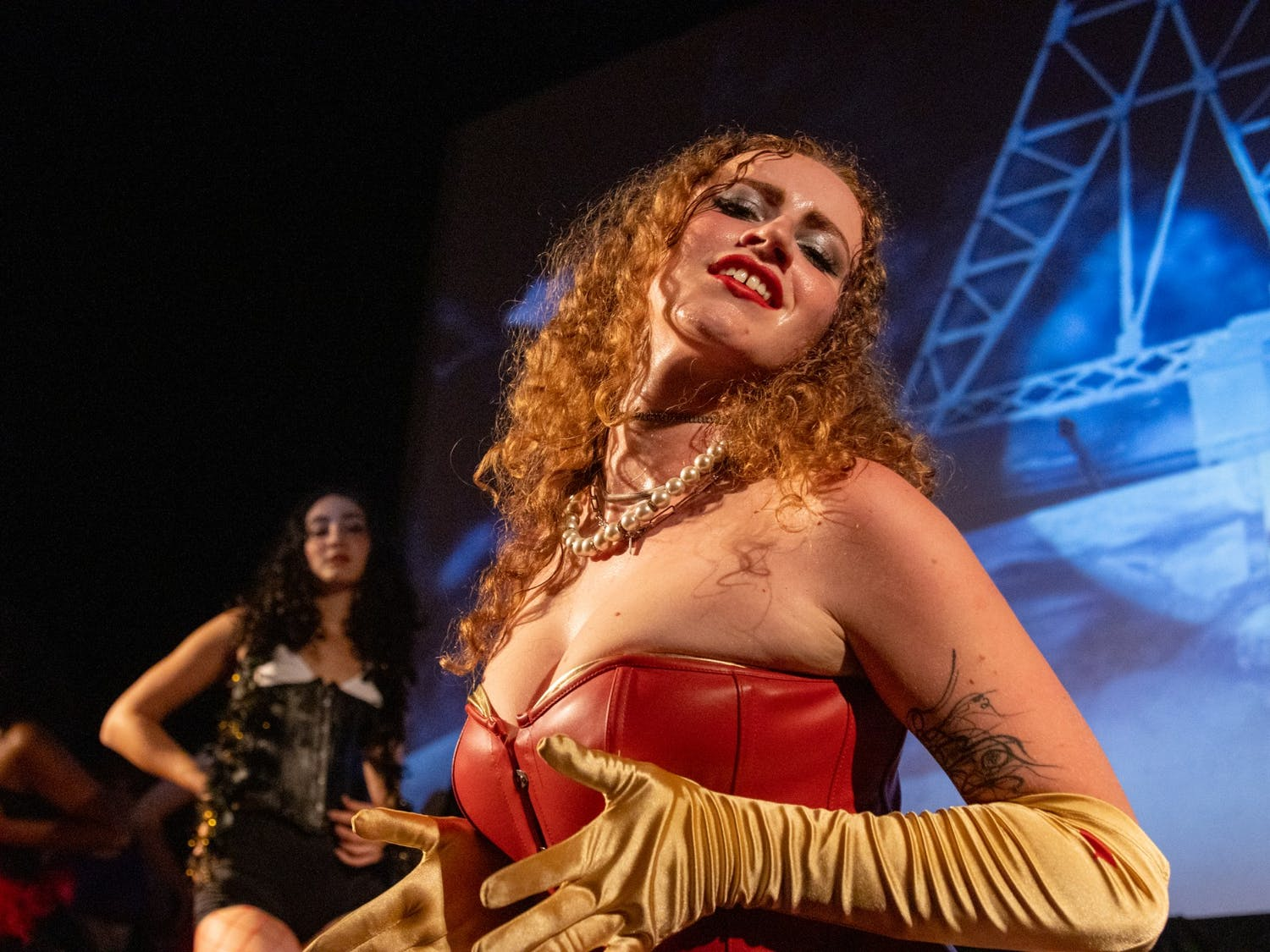 UNC senior Olivia Sullivan portrays Dr. Frank-N-Furter during the final scene of an Oct. 26 technical rehearsal of the Rocky Horror Picture Show at the Varsity Theatre. The production is an annual tradition of the UNC Pauper Players.