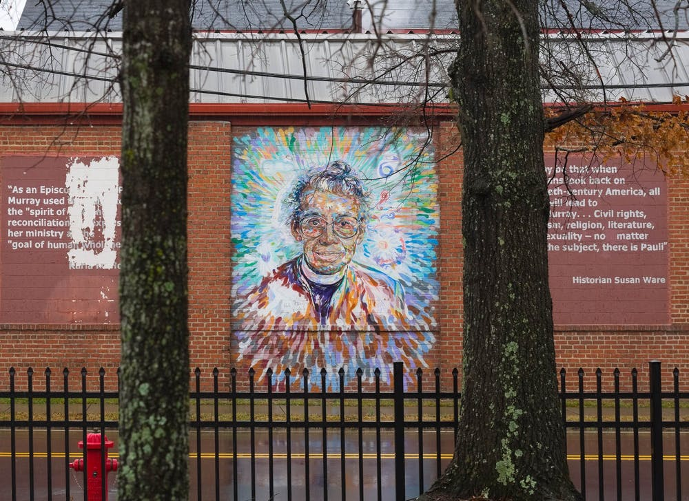 """<p>A mural of Pauli Murray, a local civil rights activist and the subject of a new WUNC podcast adorns a wall along S Buchanan Blvd in Durham on Sunday, Feb. 14, 2021. The piece is part of a collaborative public art project in Durham called """"Face Up: Telling Stories of Community Life.""""</p>"""