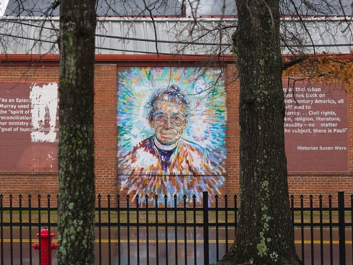 """A mural of Pauli Murray, a local civil rights activist and the subject of a new WUNC podcast adorns a wall along S Buchanan Blvd in Durham on Sunday, Feb. 14, 2021. The piece is part of a collaborative public art project in Durham called """"Face Up: Telling Stories of Community Life."""""""