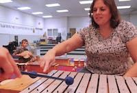Sarah Davies, a music teacher at New Hope Elementary School, teaches with materials purchased through Donorschoose.org.