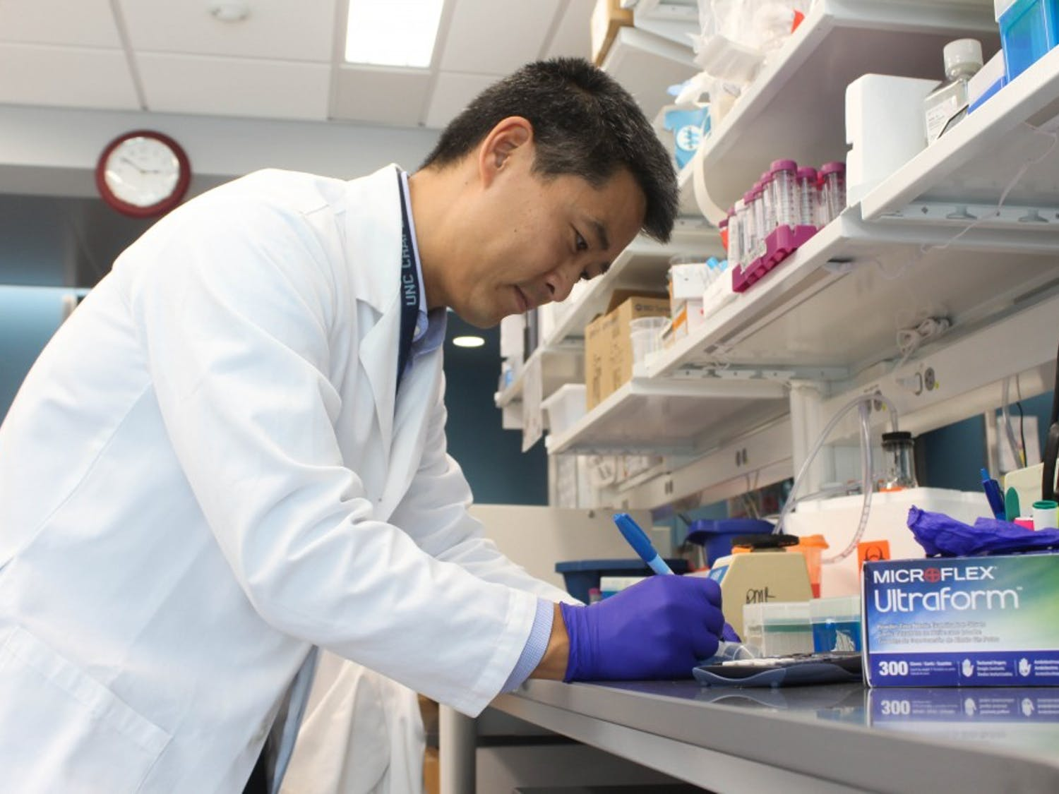 Chapel Hill resident, Dr. Edwin Kim, 55, working in the lab for the UNC Food Allergy Initiative at the Mary Ellen Jones building on Friday, Oct. 4, 2019. Kim and the UNC Food Allergy Initiative are developing peanut allergy treatments to make those with allergies less reactive to allergens. Kim's daughter and son both have nut allergies.