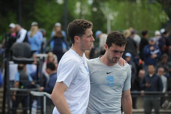 Senior Blaine Boyden comforts junior William Blumberg after his singles loss at the ACC tournament semifinals. UNC played against Virginia and lost 3-4. Blumberg won his doubles match with senior Blaine Boyden and lost his singles match.