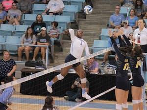 Destiny Cox (1) spikes against UNC-Greensboro in Carmichael Arena Friday, Aug. 31.