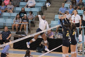 Destiny Cox (1) spikes against UNC-Greensboro in Carmichael Arena Friday, Aug. 31.