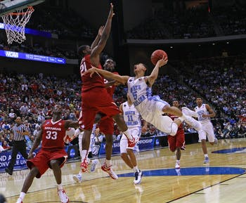 UNC guard Marcus Paige (5) goes up for a layup. The Tar Heels defeated the Arkansas Razorbacks, 87-78, on Saturday in Jacksonville, Fla.
