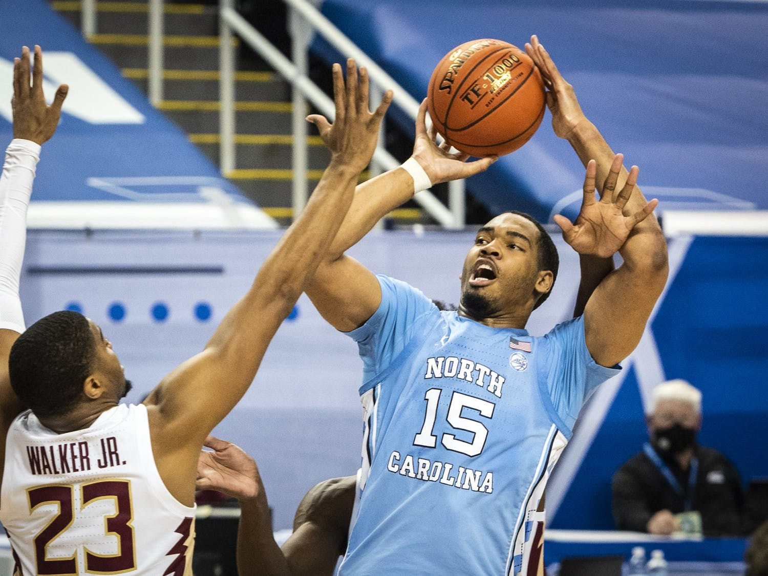 Carolina's Garrison Brooks (15) is fouled as he shoots by Florida State's Quincy Ballard (15) on Friday, March 12, 2021 in Greensboro, N.C. Photo courtesy of Andrew Dye/Winston-Salem Journal
