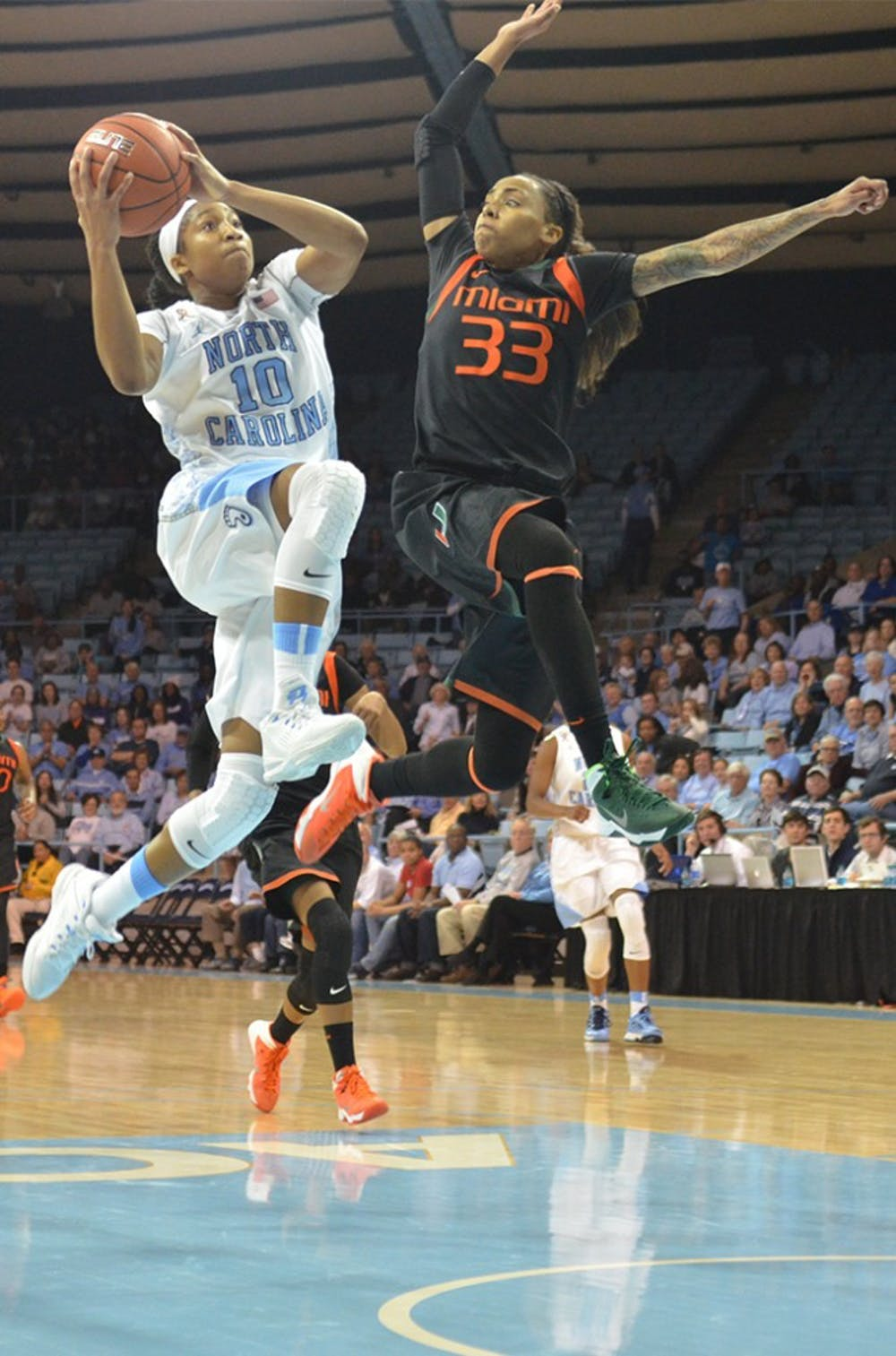 UNC guard Danielle Butts (10) makes a shot and draws a foul from Miami guard Suriya McGuire (33).