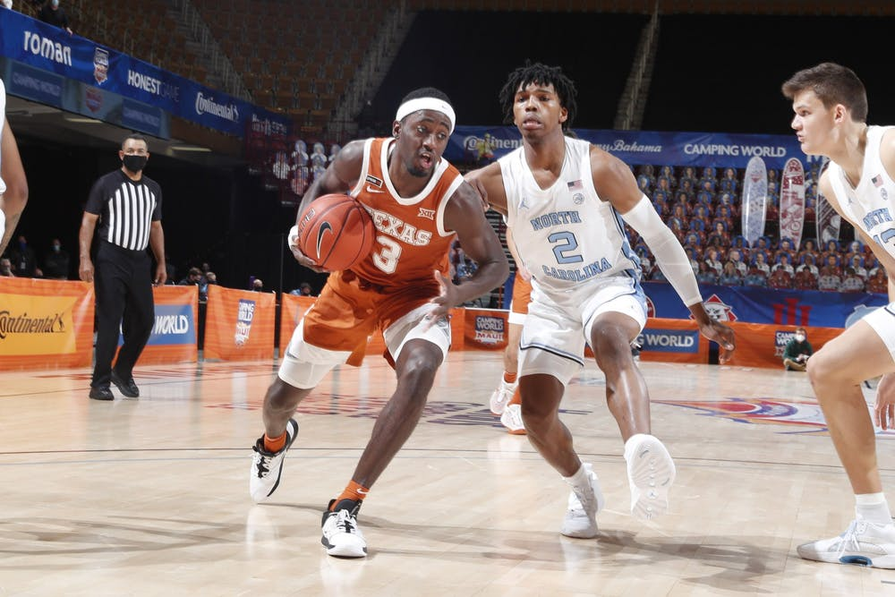 <p>UNC first year guard Caleb Love (2) defends against Texas junior guard Courtney Ramey (3) during the championship game of the Maui Invitational Tournament in Asheville, N.C. on Wednesday, Dec. 2, 2020. UNC lost the championship to Texas 69-67. Photo courtesy of Brian Spurlock/Camping World Maui Invitational.</p>