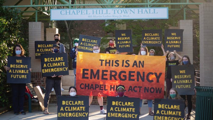 Sunrise Movement gathers outside of the Chapel Hill town hall on April 5, 2021 to demand that the town declare a climate emergency. Photo courtesy of Dana Gentry.