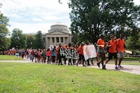 After rallying against the shut down of the UNC Center for Civil Rights, protesters march to Silent Sam to show solidarity with the sit-in.