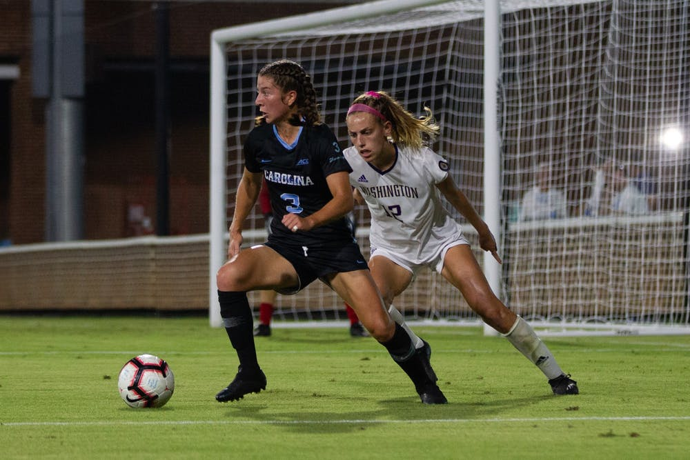 <p>UNC first-year midfielder Ruby Grant (3) passes the ball during the matchup against Washington on Thursday, Aug. 19, 2021 at Dorrance Field.</p>