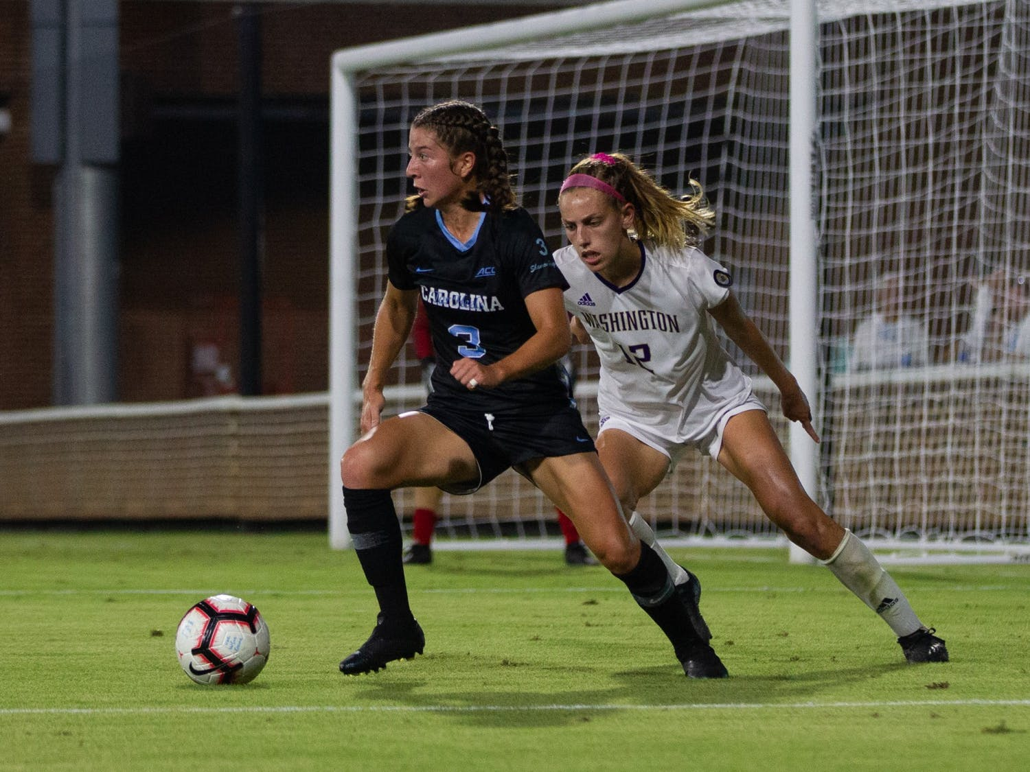 UNC first-year midfielder Ruby Grant (3) passes the ball during the matchup against Washington on Thursday, Aug. 19, 2021 at Dorrance Field.