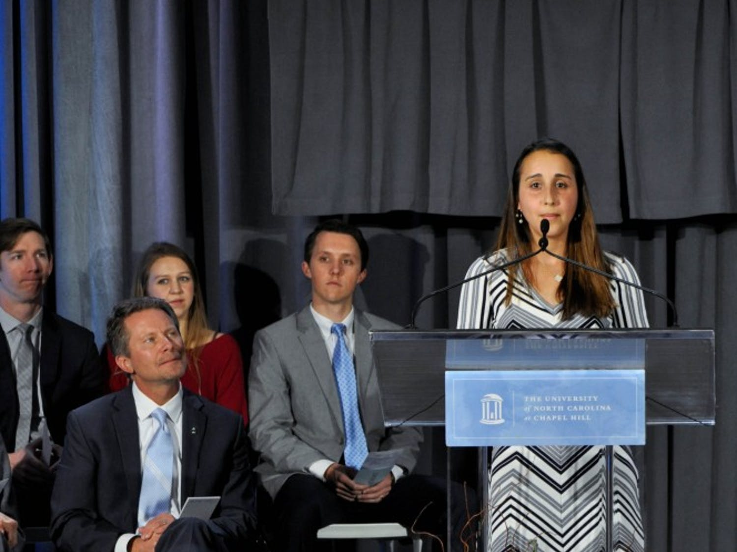 """Second-year student at the School of Dentistry and a recipient of the Dr. Claude A. Adams Jr. scholarship Pegah Khosravi-Kamrani speaks at the announcement of a $27.68 million gift to UNC's School of Dentistry in the Koury Oral Health Sciences building on Wednesday, Feb. 20, 2019. """"I pledge to use dentistry as a means to serve others facing dental hardships,"""" said Khosravi-Kamrani during her remarks."""