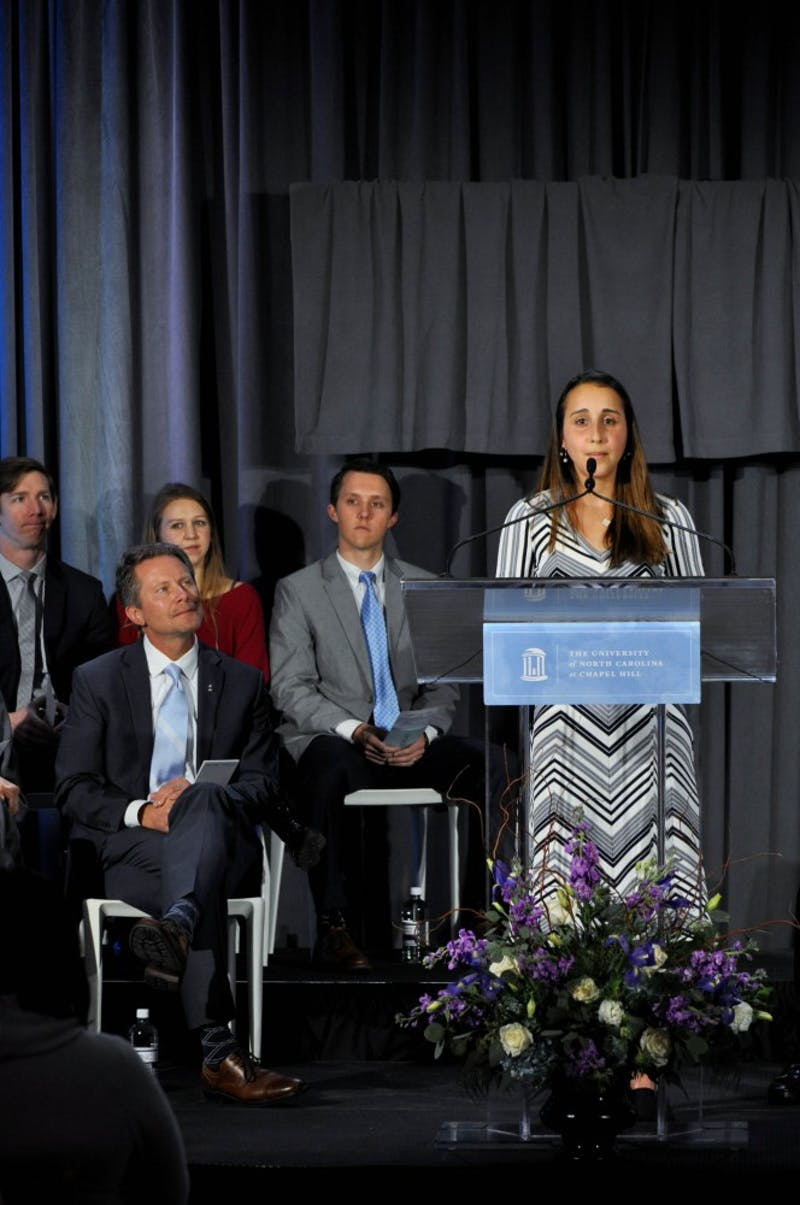 "Second-year student at the School of Dentistry and a recipient of the Dr. Claude A. Adams Jr. scholarship Pegah Khosravi-Kamrani speaks at the announcement of a $27.68 million gift to UNC's School of Dentistry in the Koury Oral Health Sciences building on Wednesday, Feb. 20, 2019. ""I pledge to use dentistry as a means to serve others facing dental hardships,"" said Khosravi-Kamrani during her remarks."